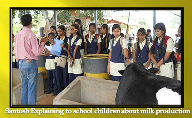 Santosh D Singh explaing about-milk-production-to-school-childrens